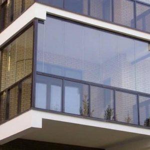 Как сделать тонировку балкона: выбор пленки, процесс тонирования